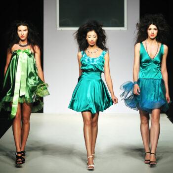 Young beautiful model walking on fashion show piste